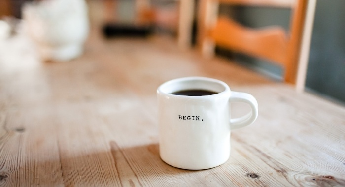 Begin on Coffee Cup