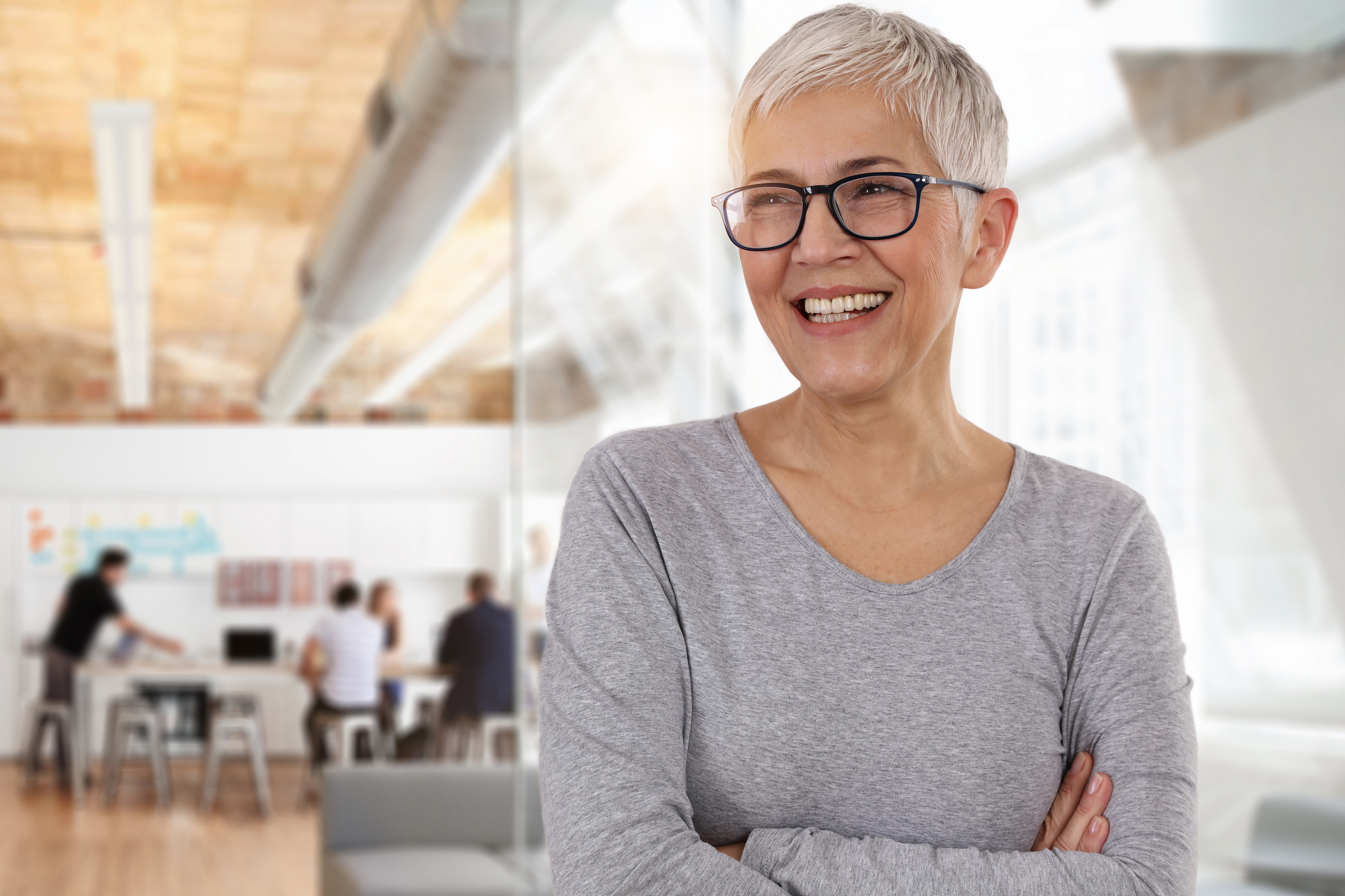 Confident female business owner smiling