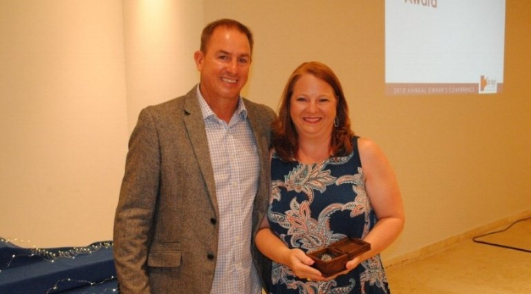 CEO Jeff Salter & Franchise owner Adie Walls with award