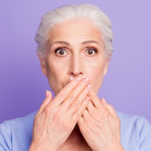 Senior women with a shocked expression and hands covering mouth-1