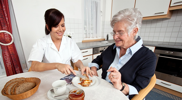 Caretaker at home with senior citizen