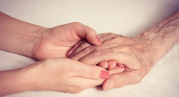 Young hands clasping old ones