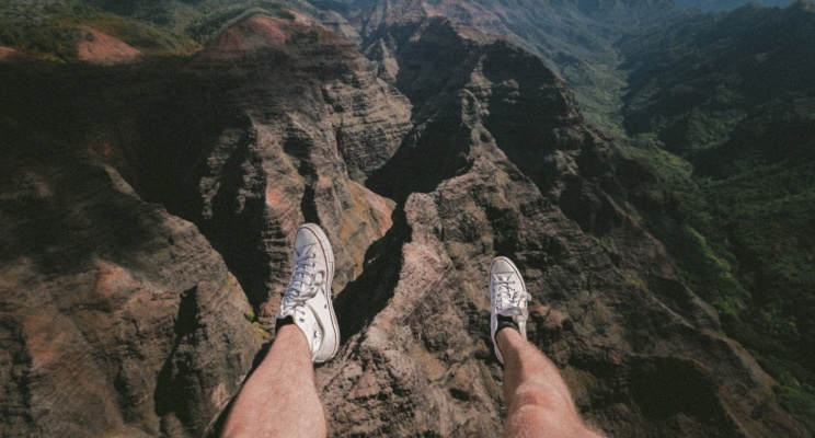 dangling feet over Grand Canyon