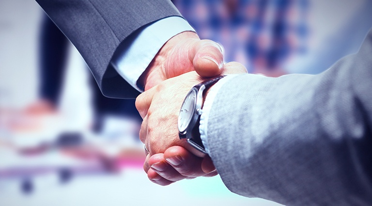 Handshake between two business men