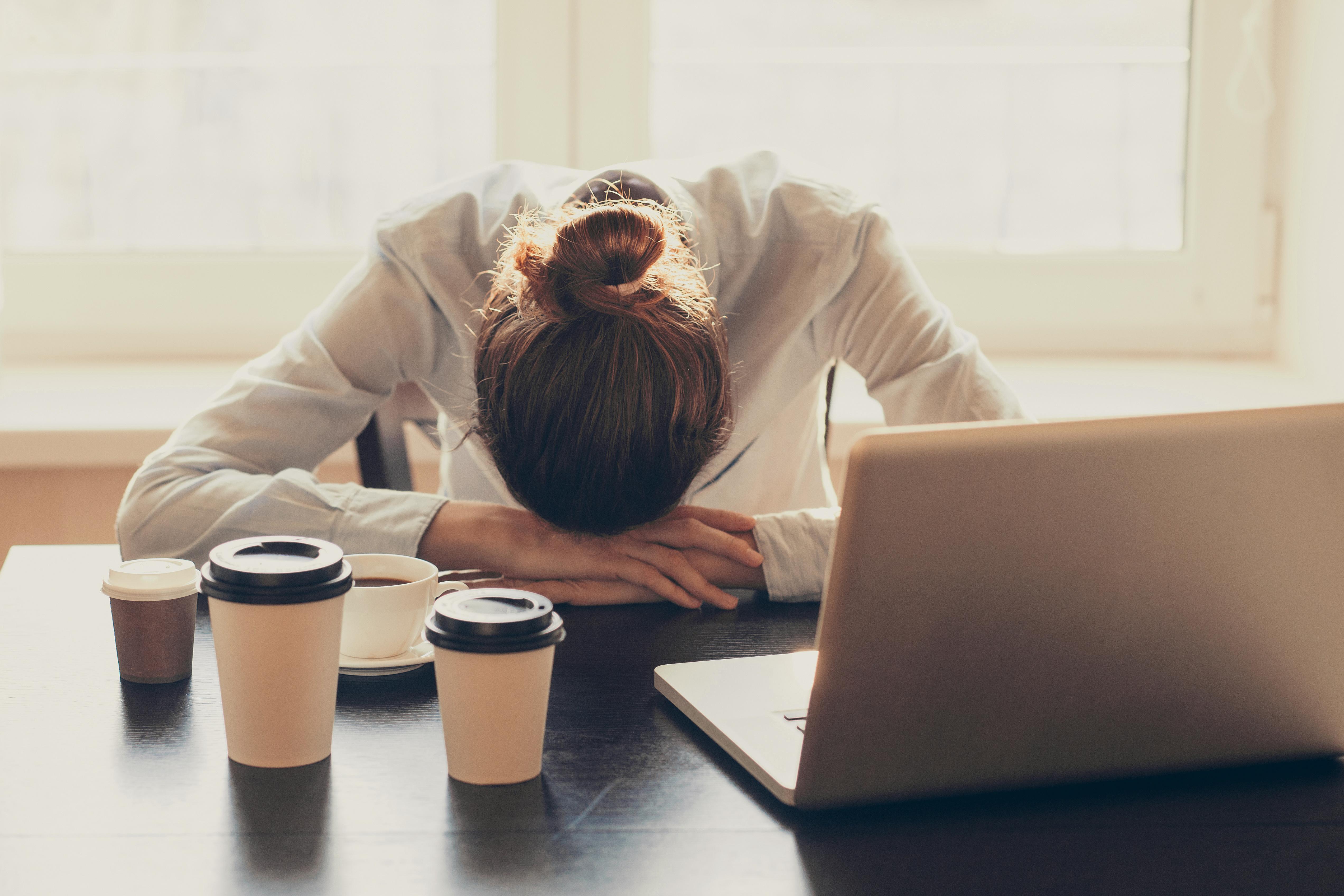 Women head on desk stressed