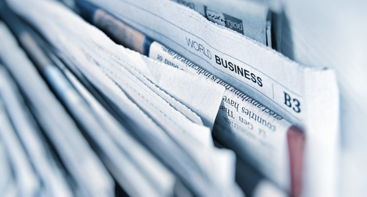 World Business title on newspaper stacks