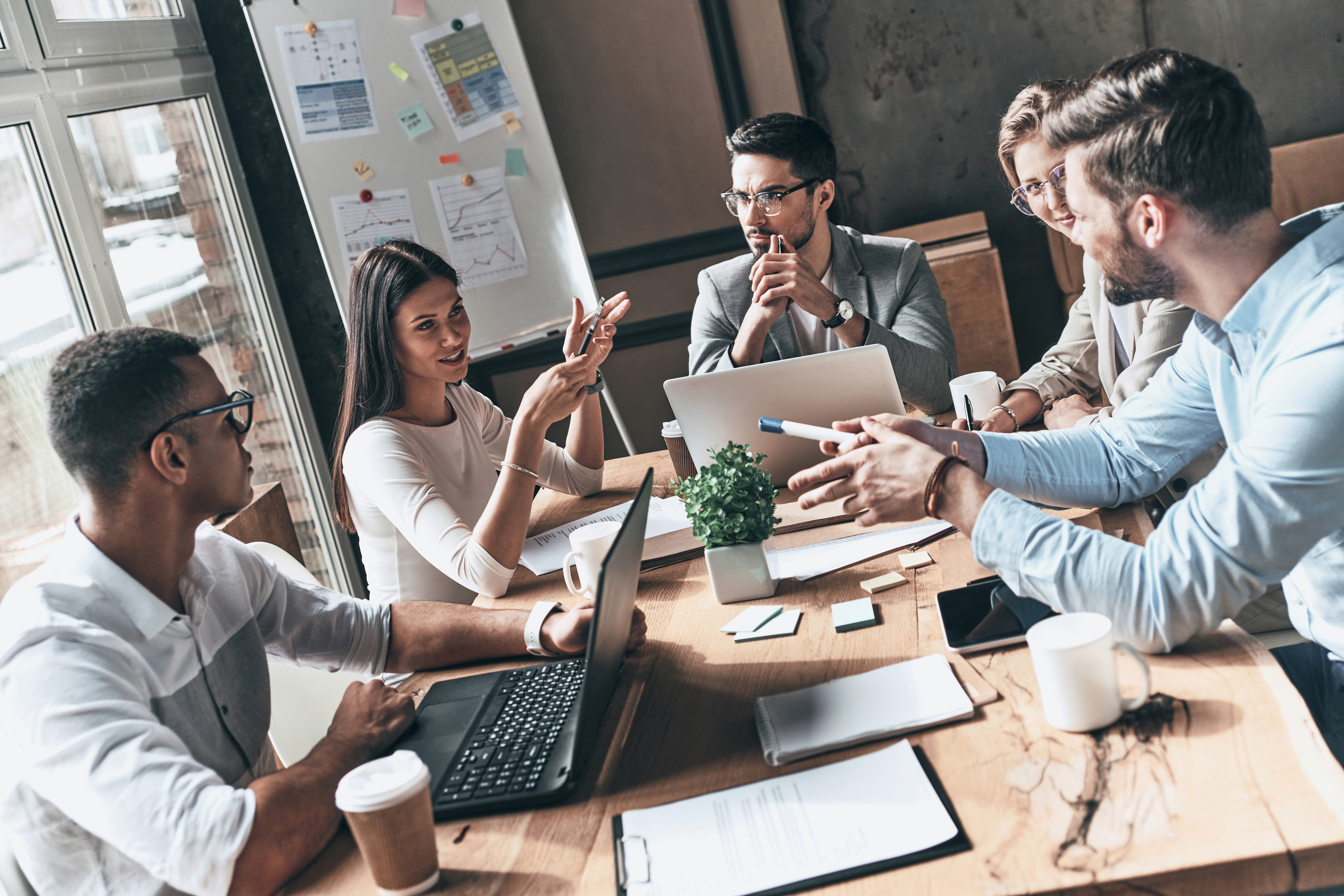 team sitting at desk during work meeting